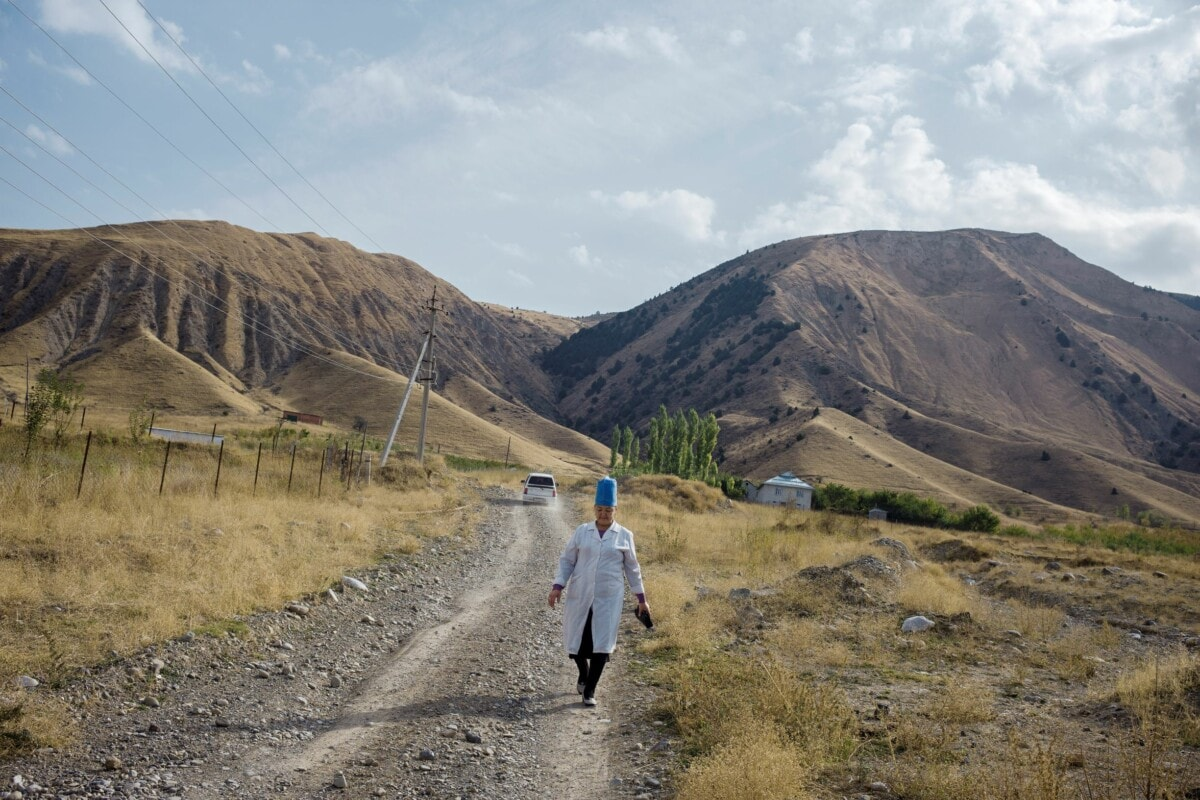 Midwife returning from a house visit, Osh region