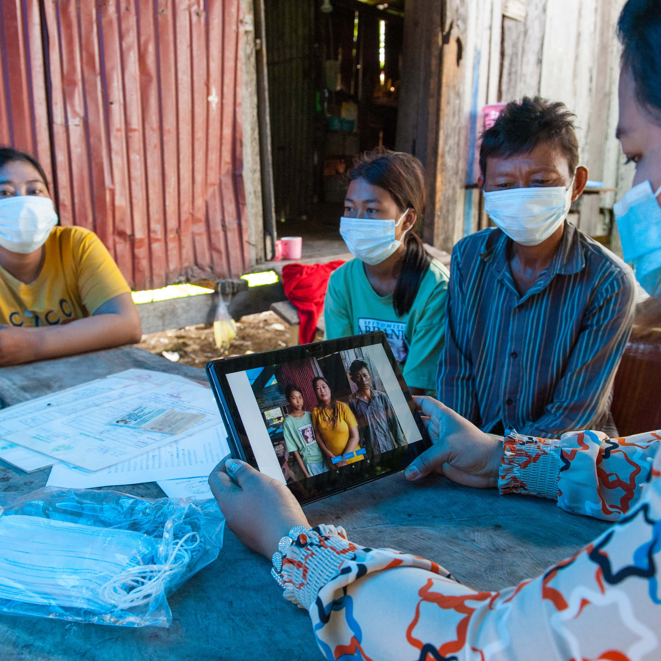 A poor family gets registered with On Demand IDPoor in Cambodia_GIZ_Connor Wall-suare