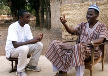 Younger and older man in Guinea