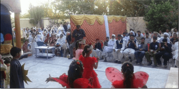 Public Meeting in Pakistan, with women and men separated by a curtain