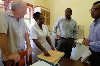 Experts from the University of Oslo meet with a nurse at Woburn Medical Station to discuss the move from paper registries to electronic data collection