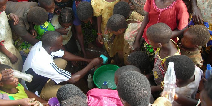 Villagers purify water in rural Malawi