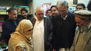 Chief Minister KP being briefed on Community Dialogues by a trainer