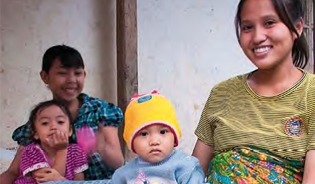 This Indonesian mother is glad that a government programme ensures access to free health care for her children and herself.