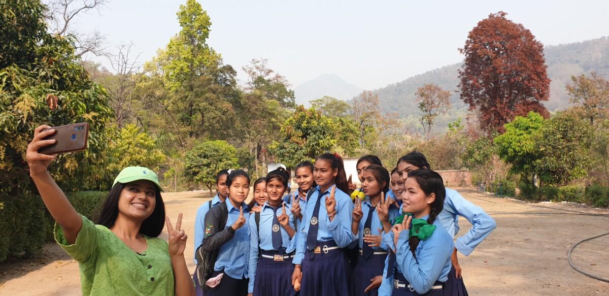 Keki Adikhari, actress and menstrual health ambassador, with schoolgirls in Dhangadhi
