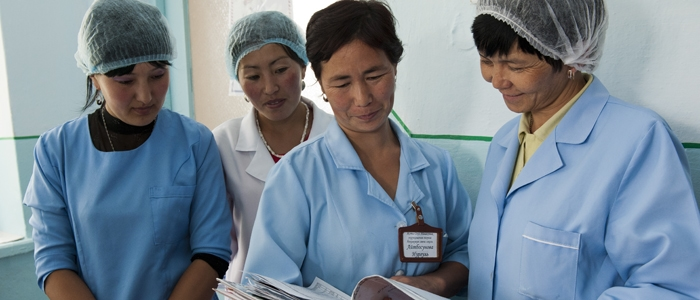 Obstetricians and midwives review patient charts at the maternity hospital in the Jety-Ogyz district of Kyrgyzstan