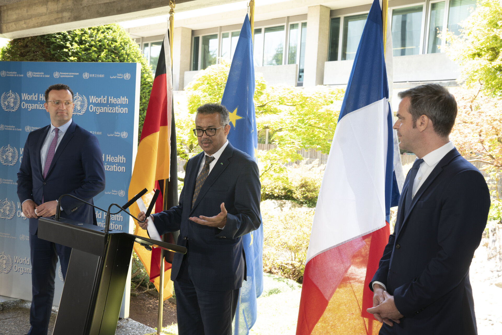 WHO Director-General, Dr Tedros Adhanom Ghebreyesus (middle) with Jens Spahn (left), Federal Minister of Health, Germany and Olivier Veran (right), Minister for Solidarity and Health, France, during a meeting for ministers of health in June 2020