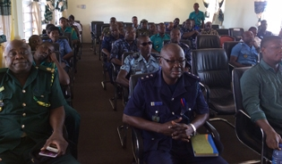 Customs officers with the Ghana Revenue Authority are joined by immigration and port health officials at an Ebola sensitization session in August 2014