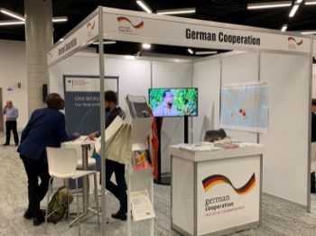 """Dialogue with visitors at the """"German Cooperation"""" exhibition booth"""