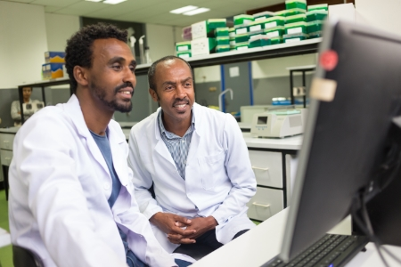 Dr Tamrat Abebe and Mr Brhanu in the HPV lab