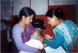 A female community health volunteer in Nepal counts an infant's respiratory rate