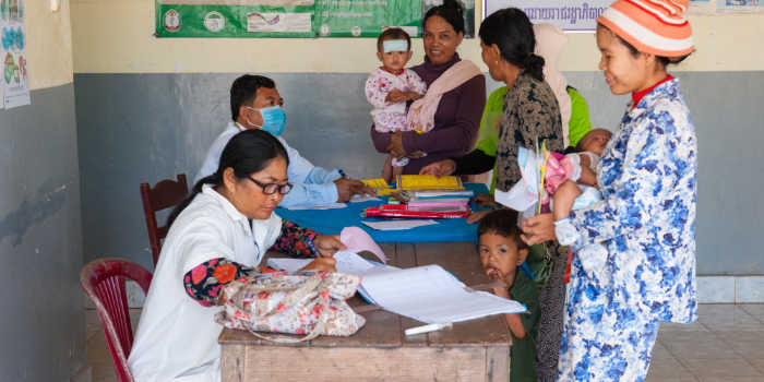 Cambodian mothers bring their children for health checks