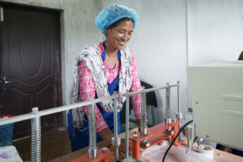 Women from the community cooperative produce low-cost sanitary pads