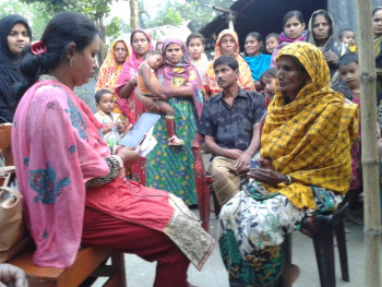 SSK Scheme Operator employee (left) registers Bolla traditional birth attendant.