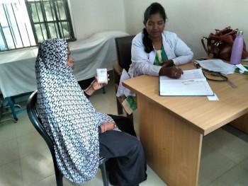 Cardholder consulting an SSK doctor at Kalihati hospital