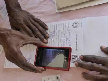 Scanning codes to link paper and digital records