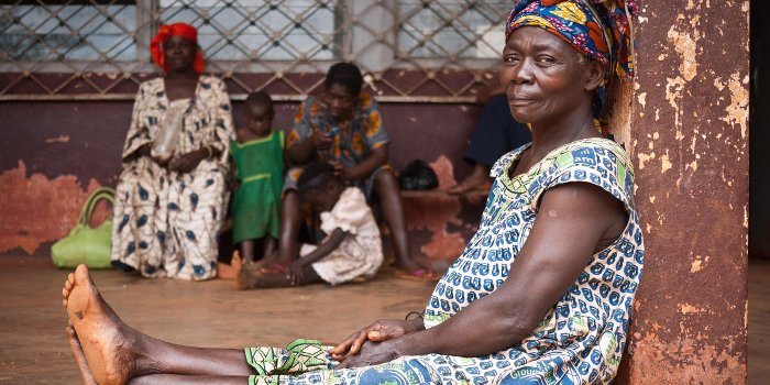 A woman waits with her family for treatment at the district clinic in Cameroon 2012