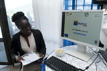 Judith Chirwa, EU delegation, watches MedNet presentation