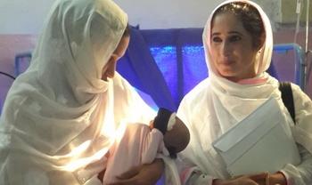 WHO-SCC coordinator Ashfa Hashmi (right)