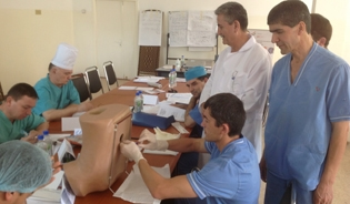 Anesthesiologists practice administering spinal anesthesia on mannequins at Maternity Hospital No. 3 in Dushanbe, Tajikistan