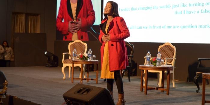 Deepa Bohara reciting her poem