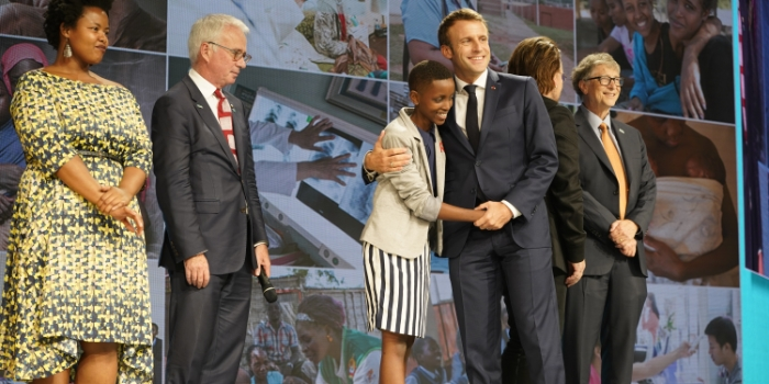 (from the left) Zolelwa Sifumba, Peter Sands, Amanda Dushime, Emmanuel Macron, Bono and Bill Gates on the Conference Stage