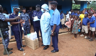 Officials with the Ghana Revenue Authority hand over protective equipment to customs officers working at border crossings.