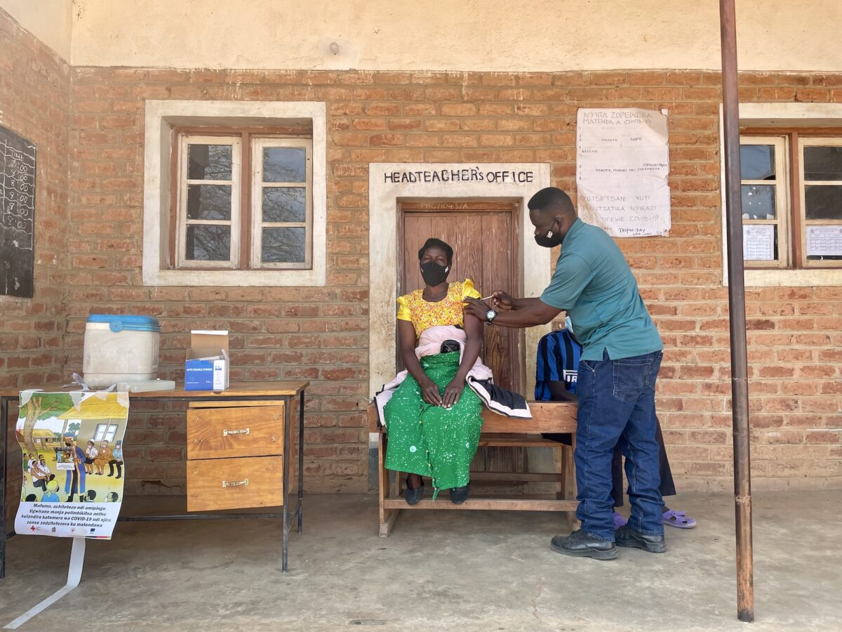 Woman in Malawi getting vaccinated after attending awareness raising event