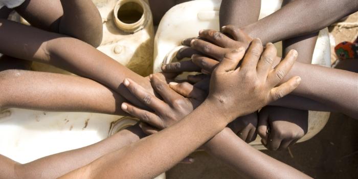 Africa children's Hands over water jugs