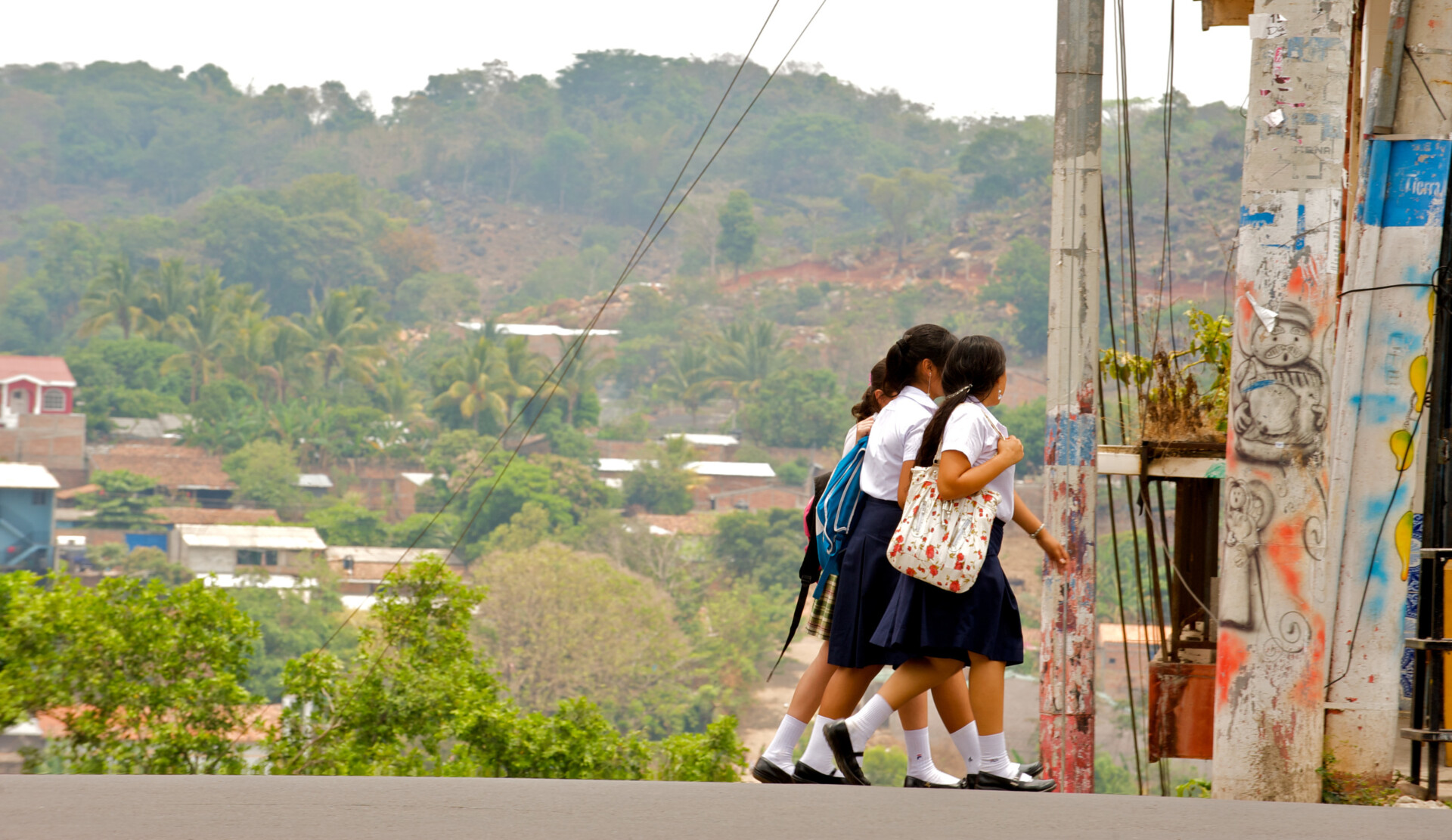 Three girls going to school in the town of San Rafael, El Salvado